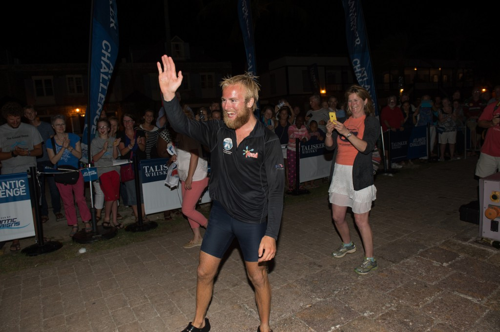 Callum Gathercole celebrates at the finish line of the Talisker Whisky Atlantic Challenge CREDIT TED MARTIN