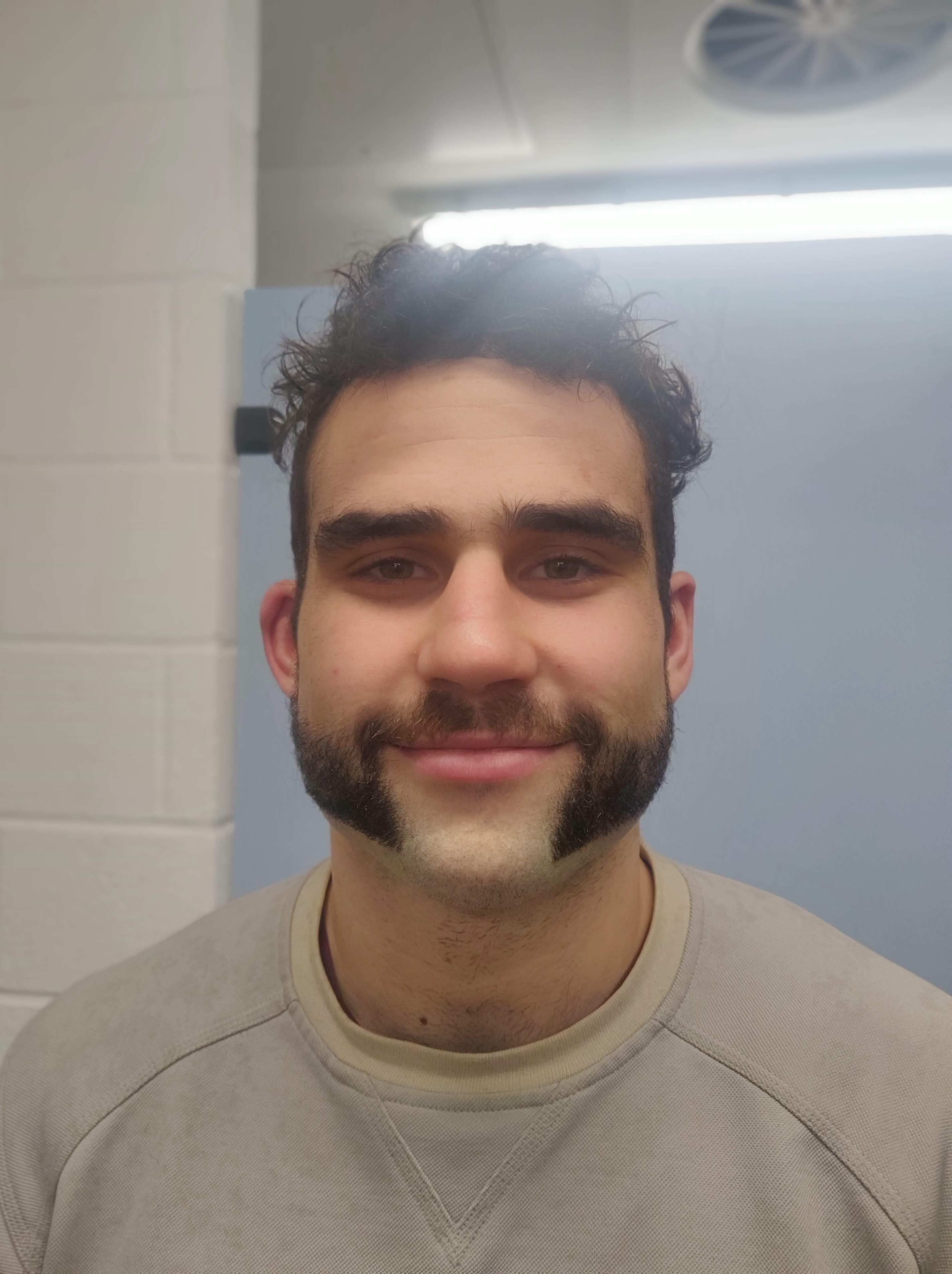 Image may contain: Man, Beard, Person, Human, Face