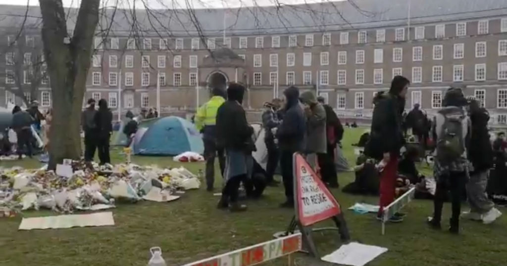 Bristol Live protest on college green with tents and people gathered
