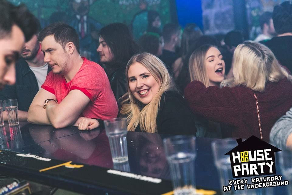 Image may contain: Pub, Bar Counter, Night Life, Night Club, Dating, Club, Party, Human, Person