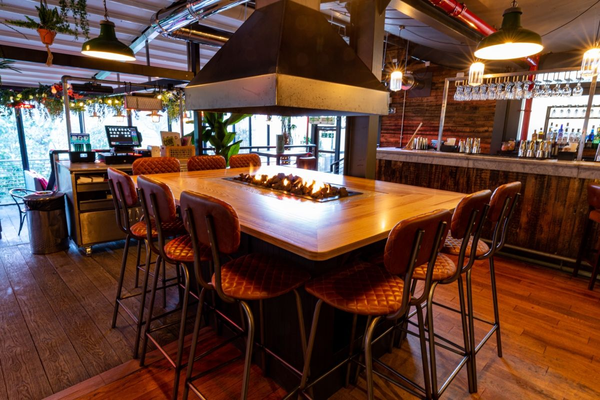 Image may contain: Alcohol, Drink, Beverage, Food Court, Food, Lighting, Bar Counter, Pub, Wood, Dining Table, Table, Dining Room, Restaurant, Room, Interior Design, Indoors, Chair, Furniture