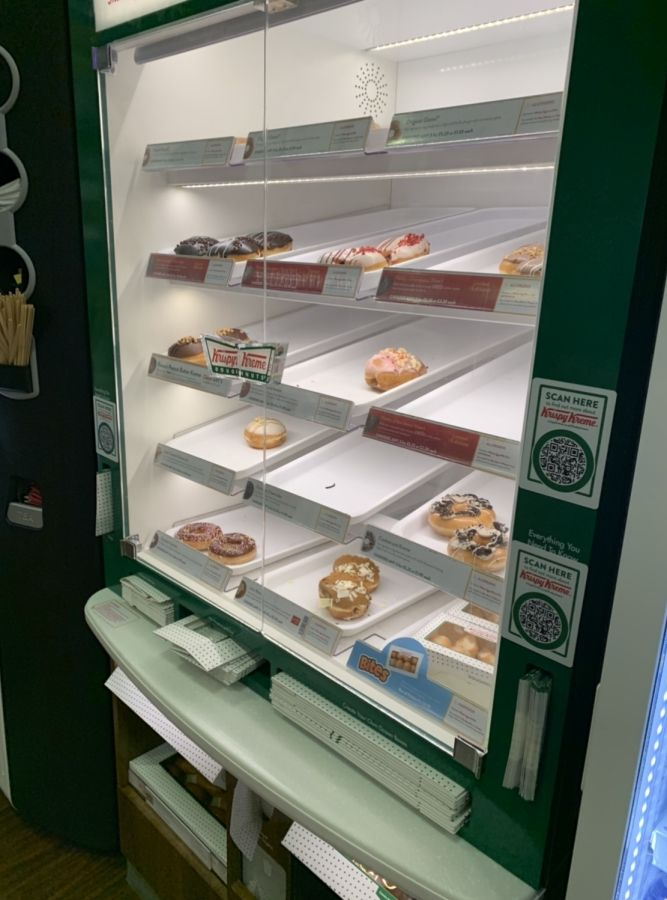 Image may contain: Machine, Shop, Bakery, Shelf, Refrigerator, Appliance