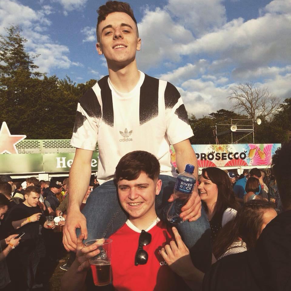 Pearse on his friend Darren's shoulders