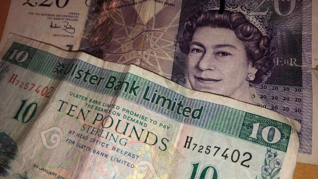Image may contain: Person, Human, Dollar, Money