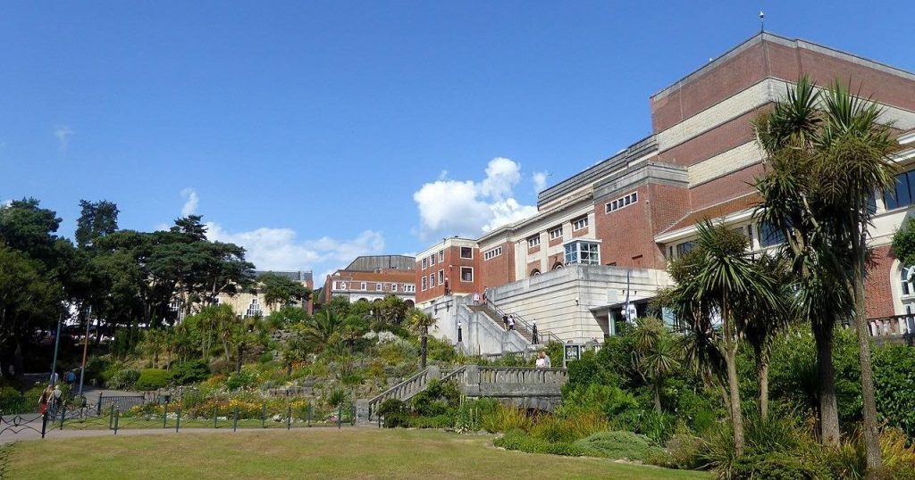 Image may contain: Building, Outdoors, Human, Person, Campus, Plant, Grass