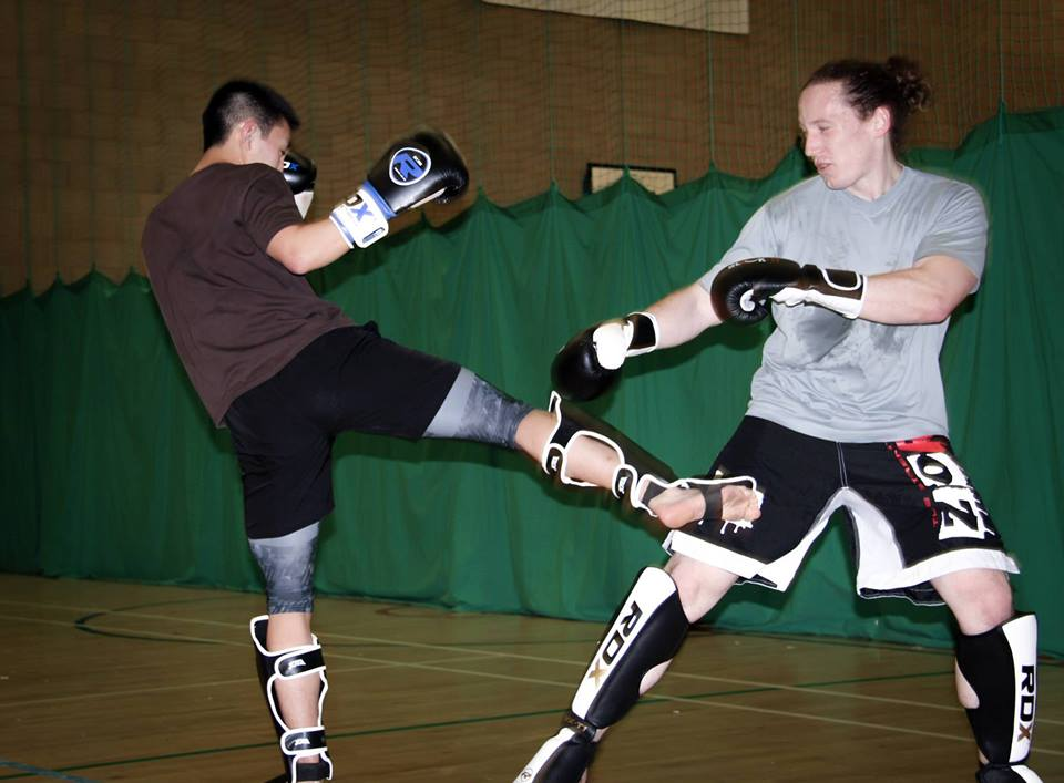 A beautiful round kick during a muay thai session
