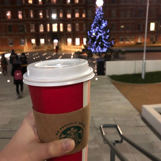 Image may contain: Building, Urban, City, Town, Downtown, Latte, Beverage, Drink, Milk, Plant, Tree, Cup, Coffee Cup, Person, Human