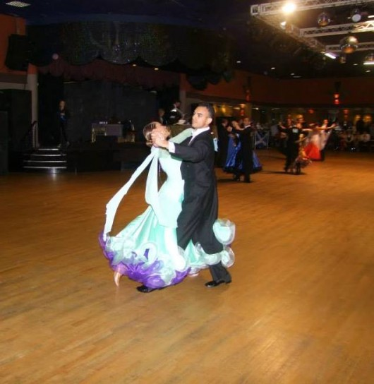 Team Captain Sophie Timbers and her partner Ali Naeem performing Quickstep