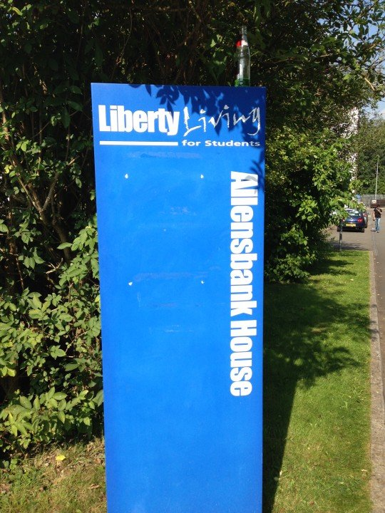 Liberty Living's expensive-looking sign afforded little protection to the students