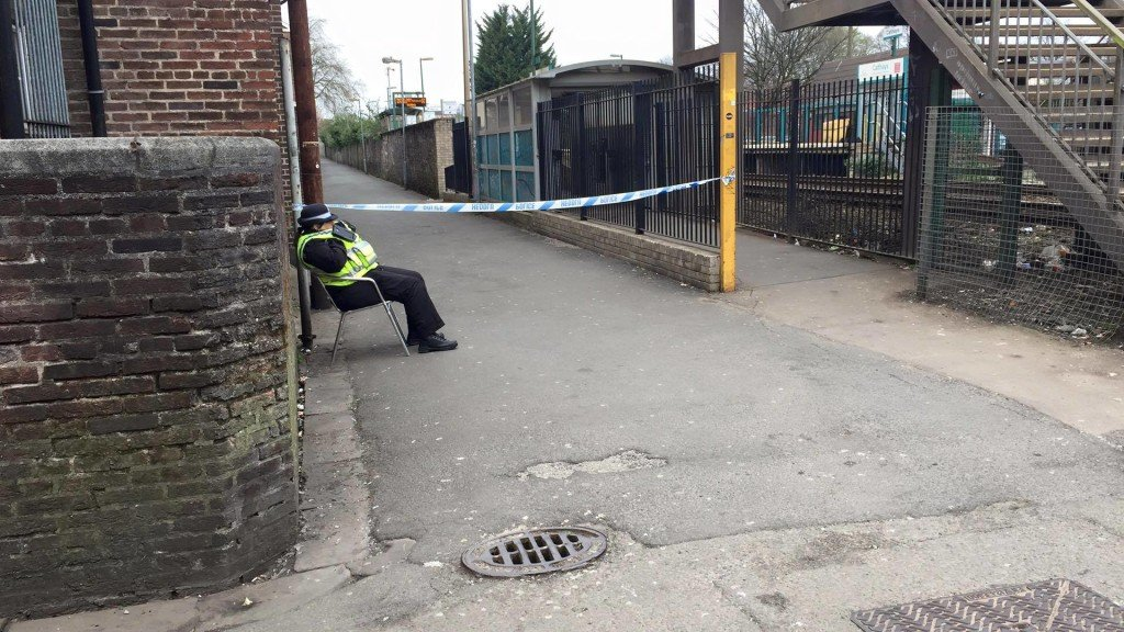 A police woman by the cordoned off area this morning