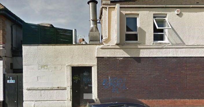 Image may contain: Brick, Pillar, Column, Building, Architecture, Door