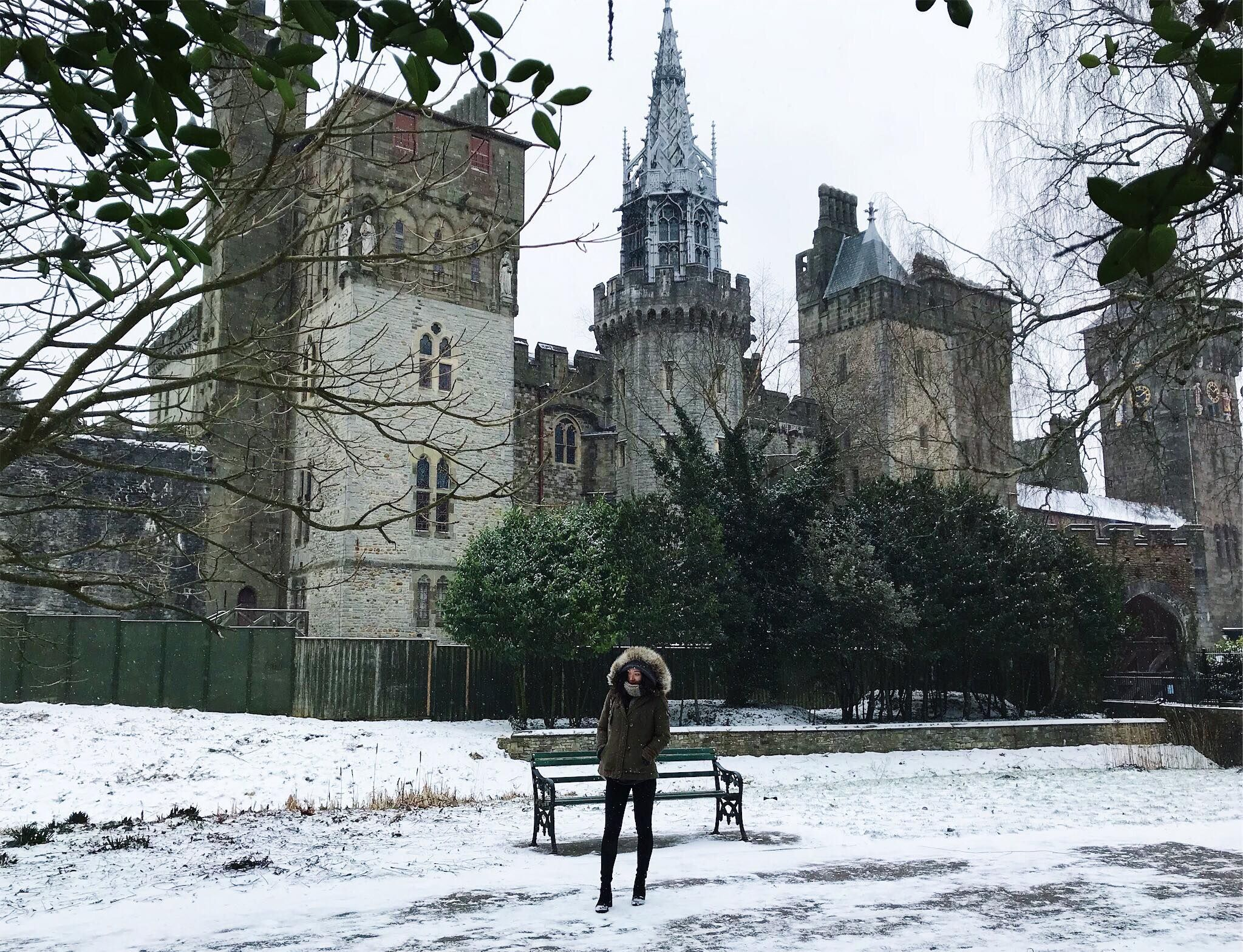 Image may contain: Ivy, Bench, Snow, Outdoors, Tree, Plant, Flora, Coat, Clothing, Worship, Church, Cathedral, Building, Architecture