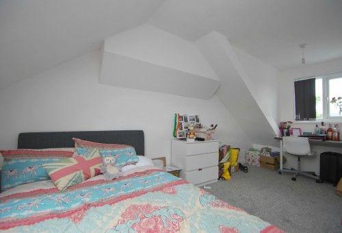 Image may contain: Attic, Interior Design, Loft, Dorm Room, Furniture, Bed, Housing, Building, Room, Bedroom, Indoors