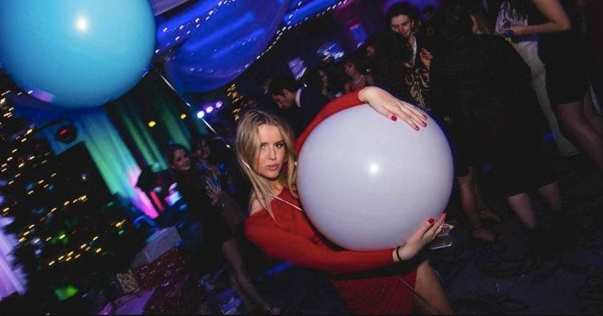 Image may contain: People, Lighting, Ball, Party, Disco, Night Life, Night Club, Club, Human, Person