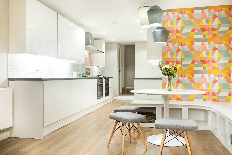 Image may contain: Vase, Ikebana, Pottery, Art, Jar, Ornament, Flower Arrangement, Flower, Blossom, Plant, Flooring, Table, Living Room, Furniture, Room, Interior Design, Indoors