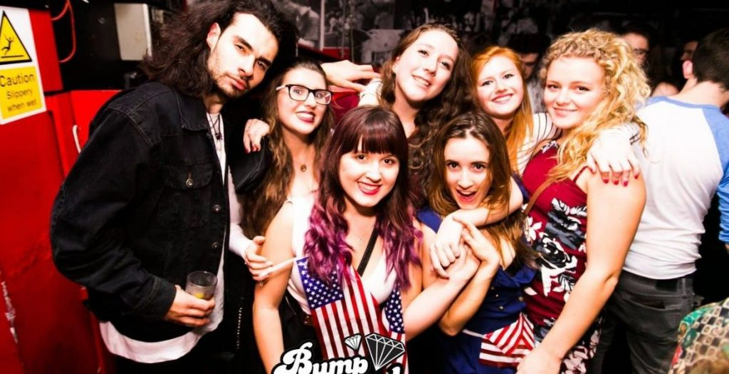 Image may contain: Club, American Flag, Night Life, Face, Flag, Symbol, Party, Glasses, Accessory, Accessories, Human, Person