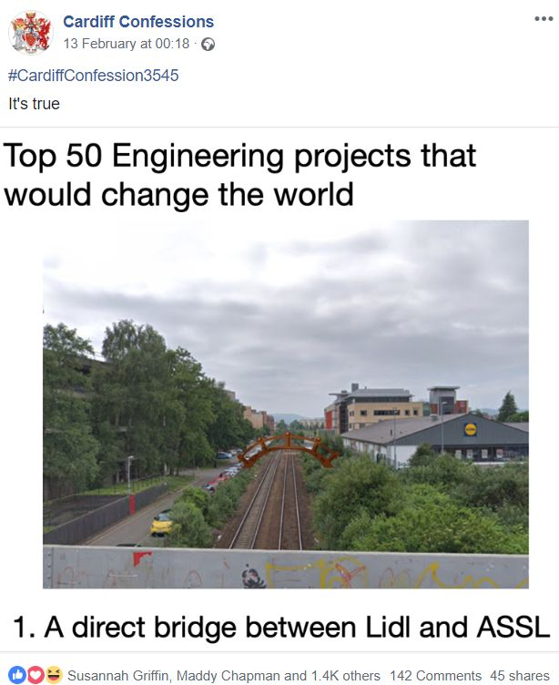 Image may contain: Advertisement, Road, Text, Train Track, Rail, Railway, Transportation