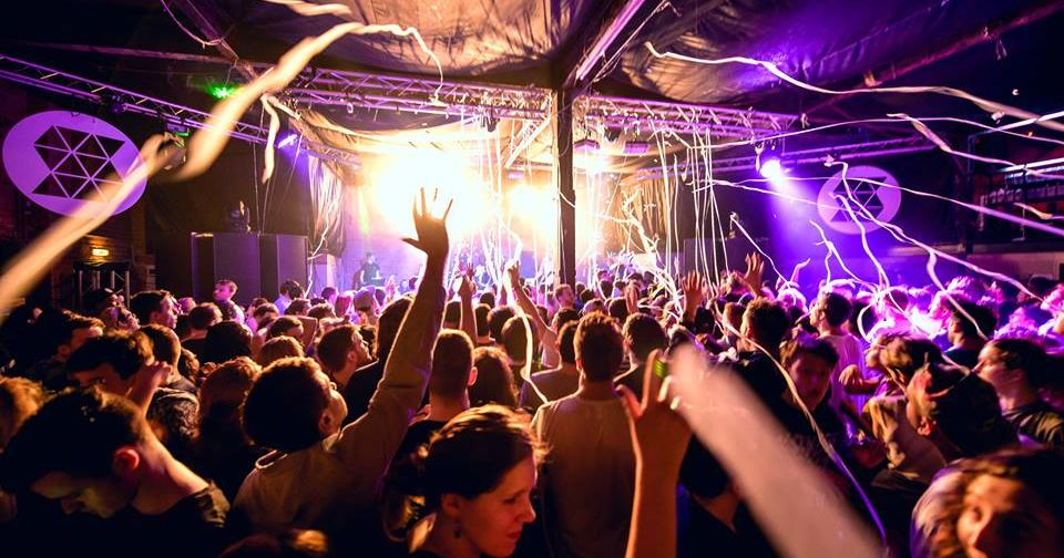 Image may contain: Audience, Rock Concert, Disco, Concert, Party, Crowd, Night Life, Night Club, Club, Human, Person