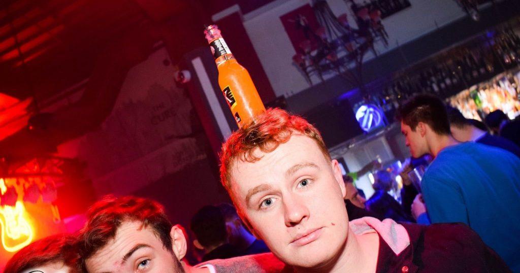 Image may contain: Night Life, Bar Counter, Pub, Human, Person, Night Club, Club