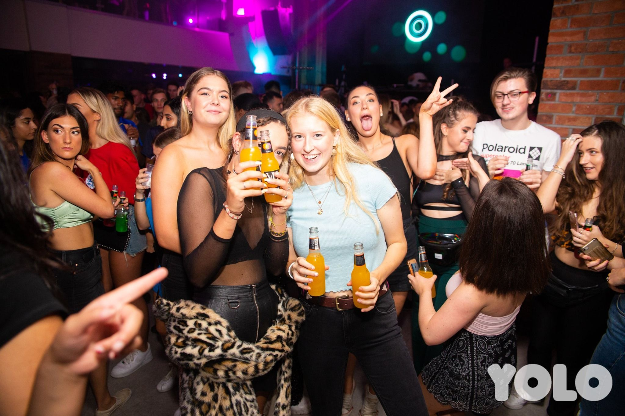 Image may contain: Night Club, Beverage, Drink, Beer, Alcohol, Club, Night Life, Person, Human, Party