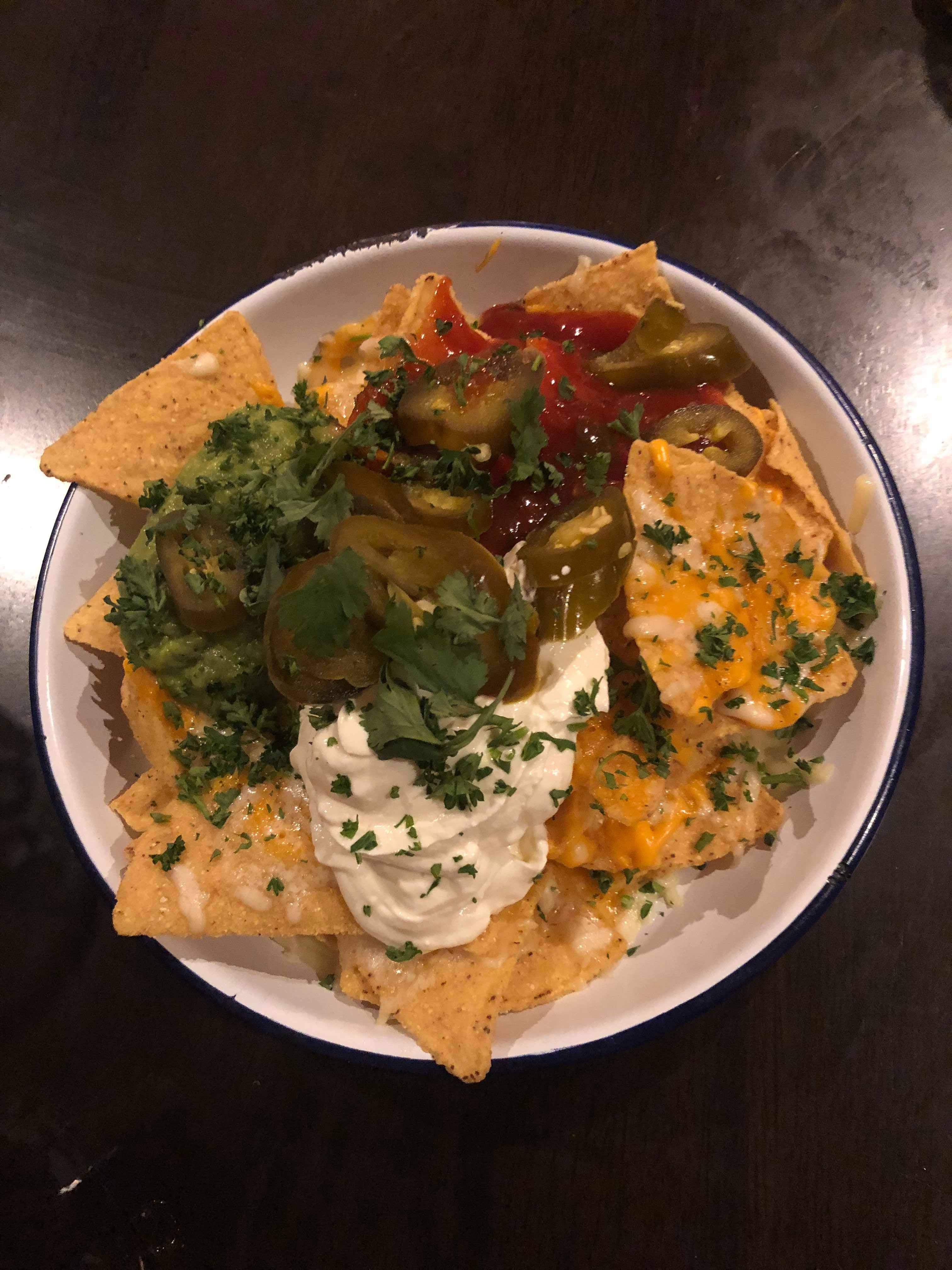 Image may contain: Nachos, Meal, Dish, Food