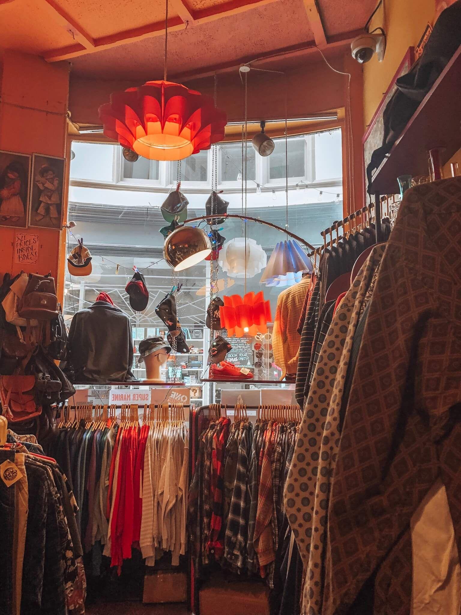 Image may contain: Wildlife, Mammal, Giraffe, Animal, Person, Human, Boutique, Market, Bazaar, Clothing, Apparel, Shop