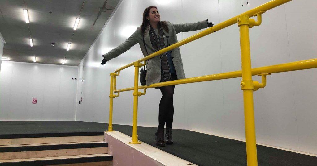 Image may contain: Corridor, Staircase, Clothing, Apparel, Person, Human, Railing, Banister, Handrail