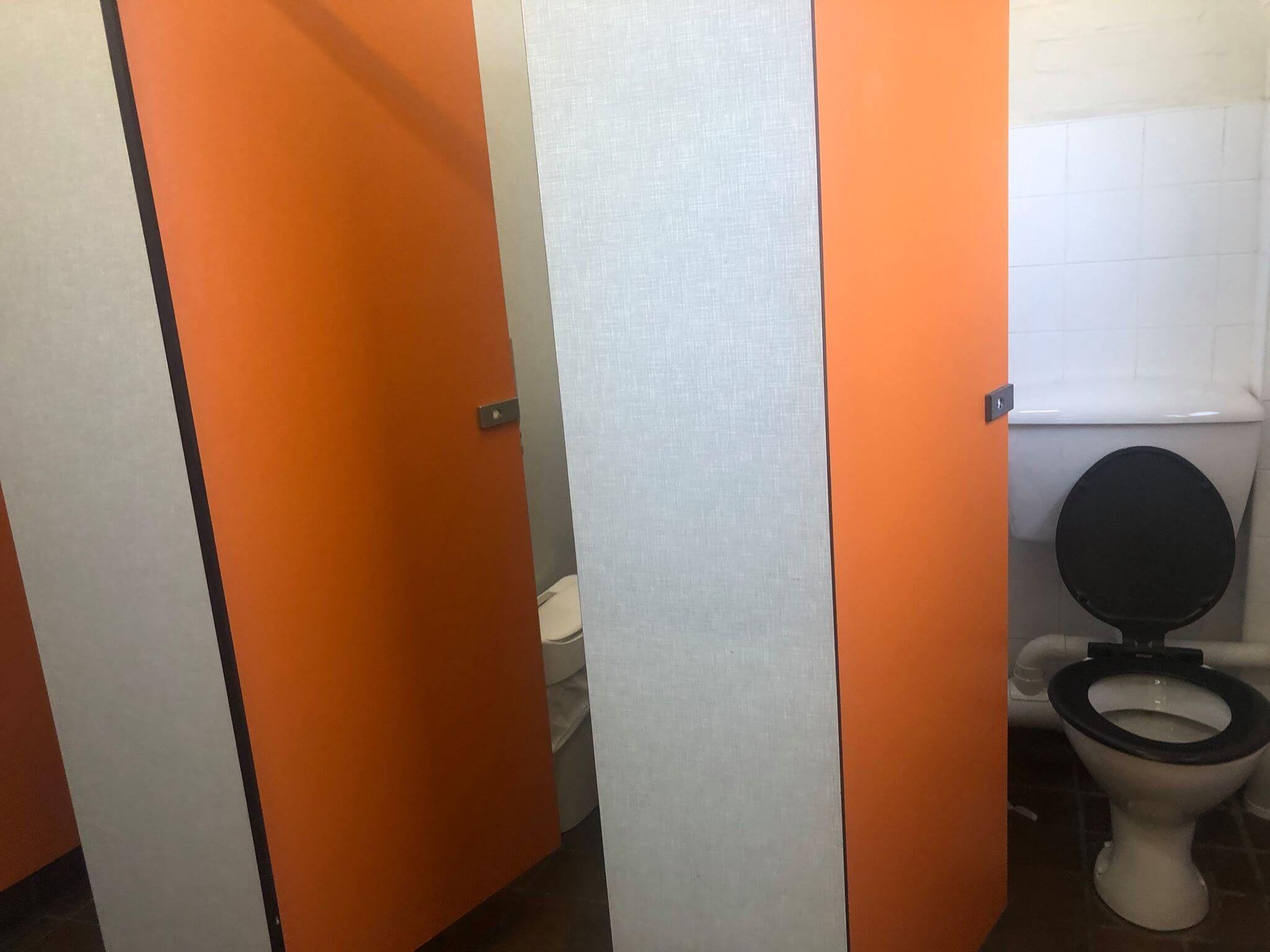 Image may contain: Flooring, Screen, Door, Electronics, Toilet, Bathroom, Room, Furniture, Corner, Indoors, Interior Design