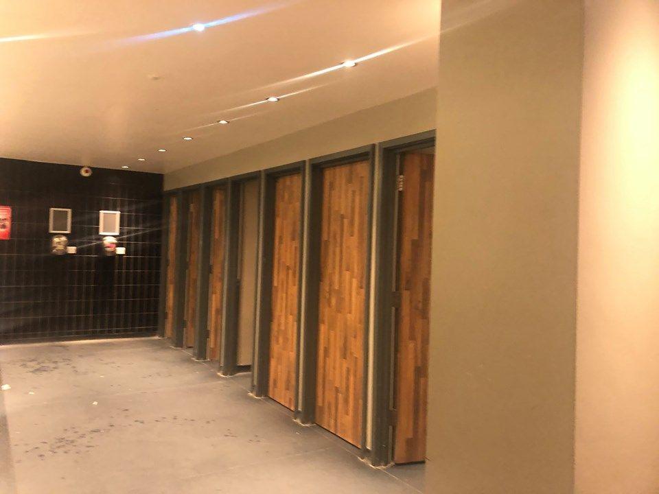 Image may contain: Interior Design, Basement, Lighting, Folding Door, Corridor, Floor, Lobby, Room, Indoors, Door