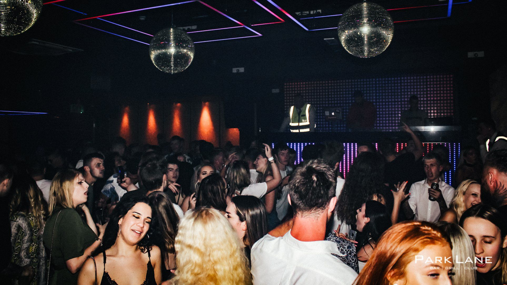Image may contain: Party, Night Life, Disco, Ceiling Fan, Appliance, Night Club, Club, Person, Human