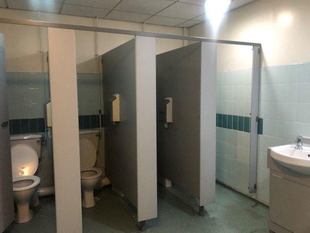 Image may contain: Sink, Door, Bathroom, Toilet, Indoors, Room