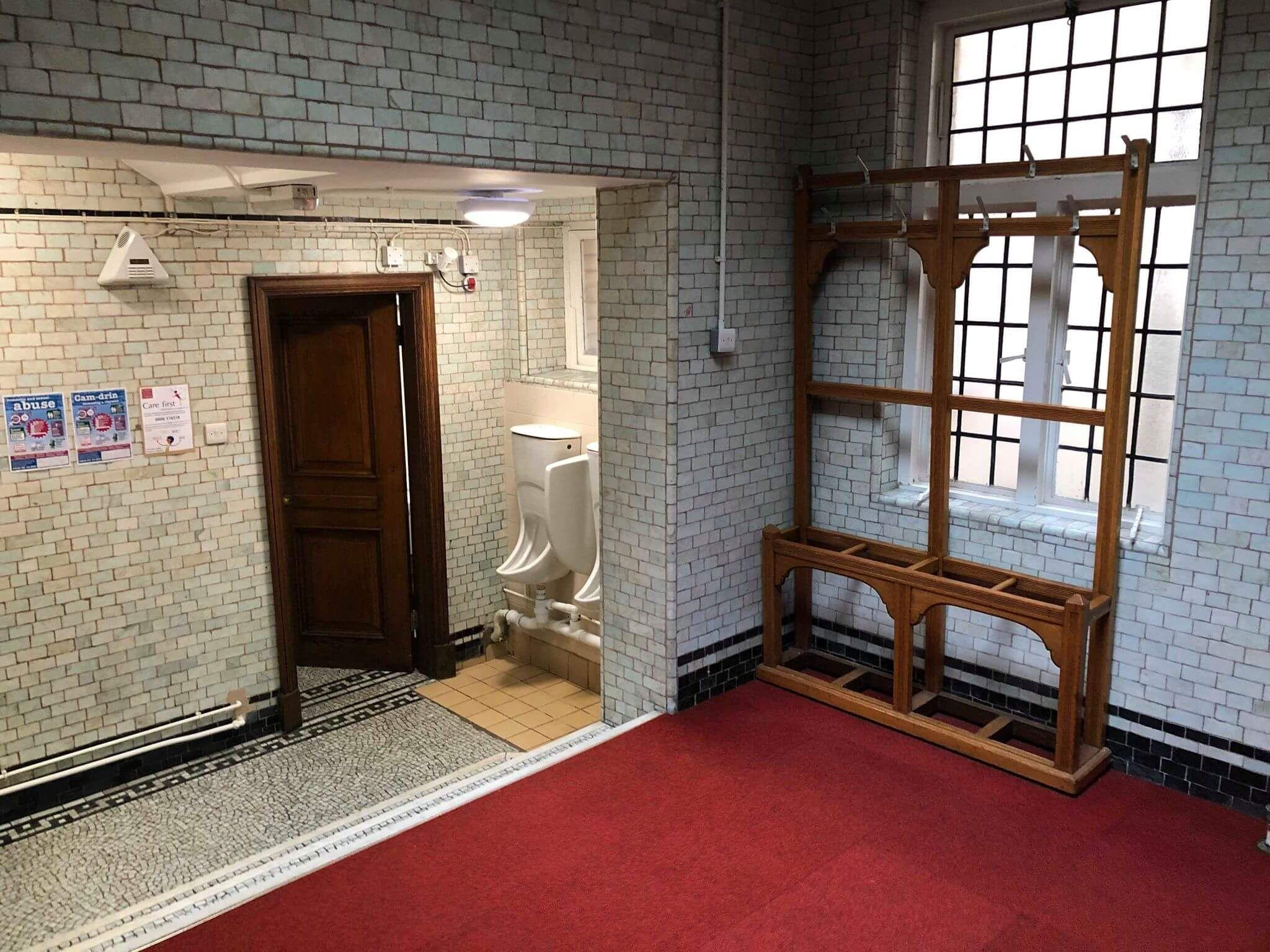 Image may contain: Toilet, Bathroom, Floor, Housing, Building, Interior Design, Room, Indoors, Flooring, Door