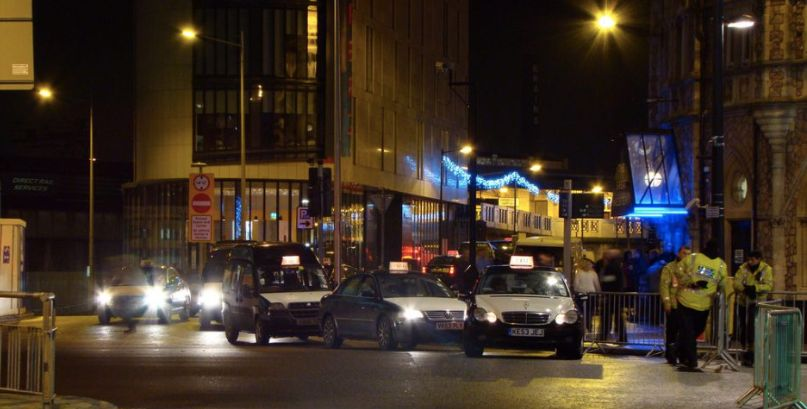 Image may contain: Traffic Jam, Pedestrian, Street, Road, Lighting, Metropolis, Urban, Town, City, Building, Human, Person, Transportation, Vehicle, Automobile, Car