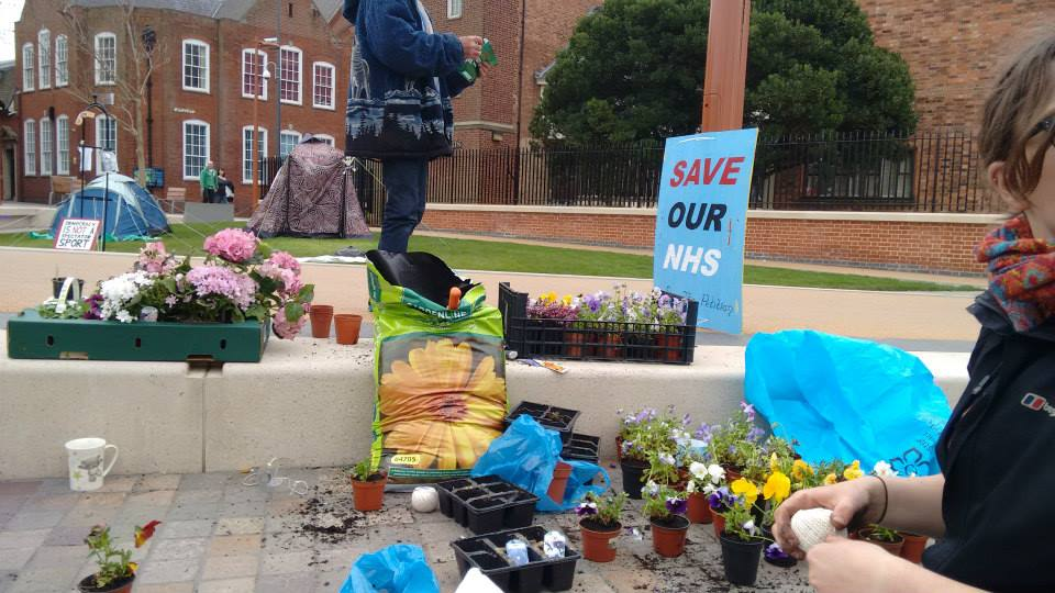 Guerilla Gardening to brighten up the streets of Leicester during their protests