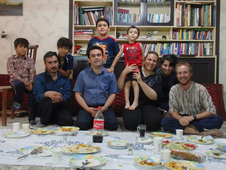 Jonathan with a host family in Iran