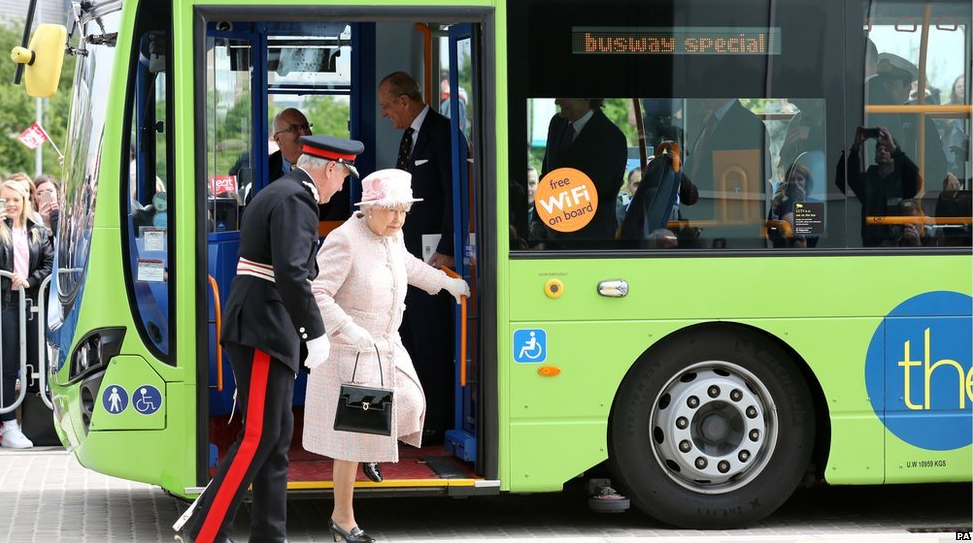 Easy does it: the Queen steps off a special service of the guided bus