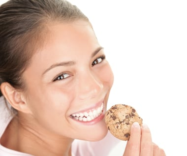 Just a wholesome girl eating a cookie. Or is she?