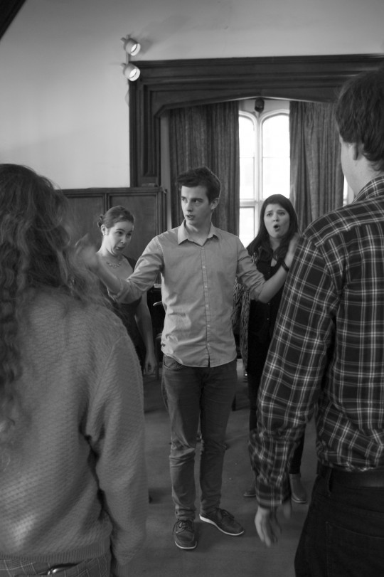 Musical director Benedict Kearns (centre) having a word with the cast