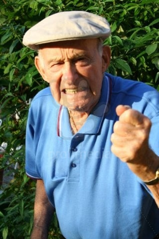 angry grumpy old man shaking his fist at the world
