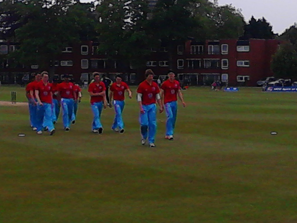 Cambridge leave the field after bowling out Oxford