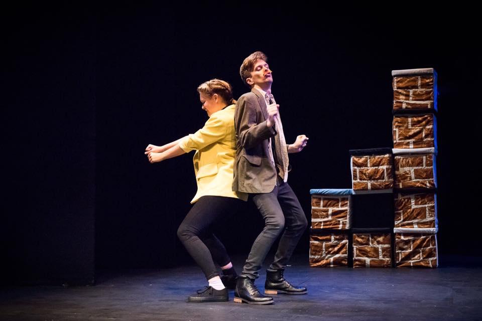 Aoife Kennan as Tranio and Robbie Taylor-Hunt as Merchant