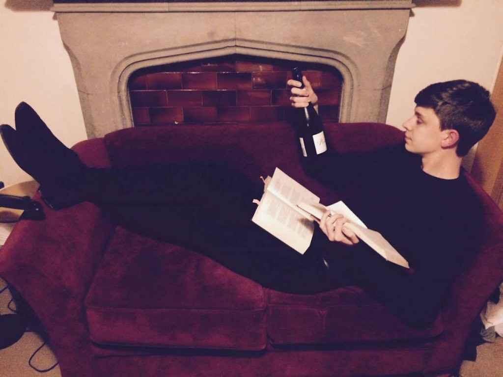 Exhibit A: Wine in one hand, book (aka symbol of procrastination) in the other. General existentialism over-compensated for by vanity all around.