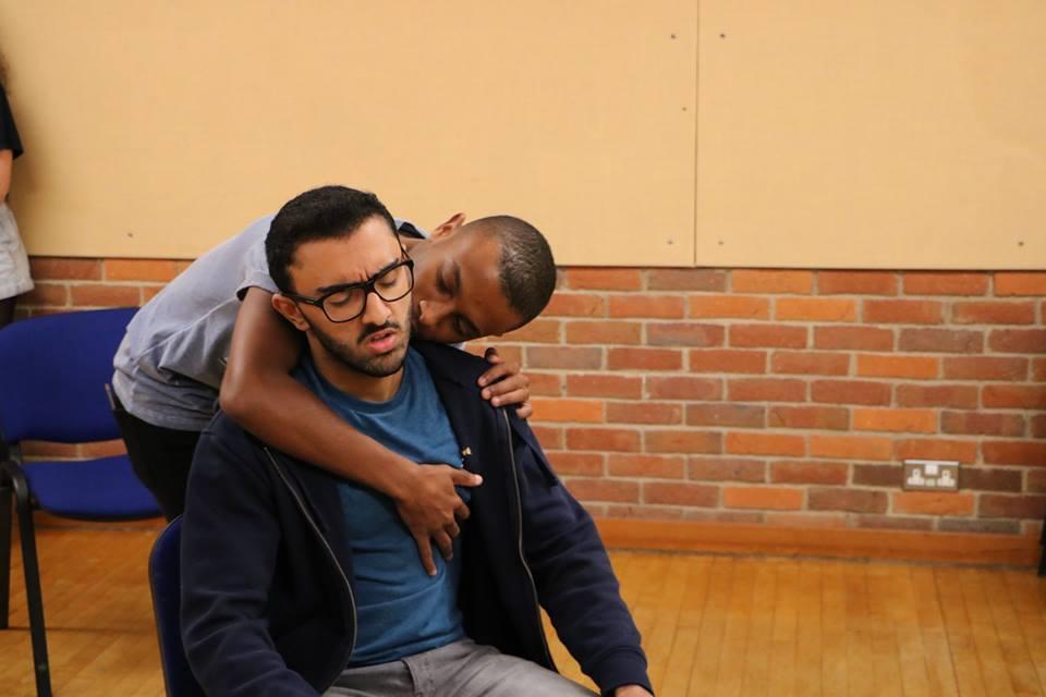 Abbas Khan (Hamed) and Joshua Marchant (ensemble) rehearse an intimate scene. Photo credits: Emma Hall