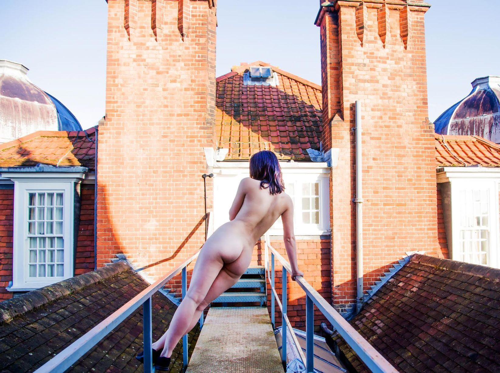 Image may contain: Swimwear, Maillot, Bikini, Brick, Human, Person, People