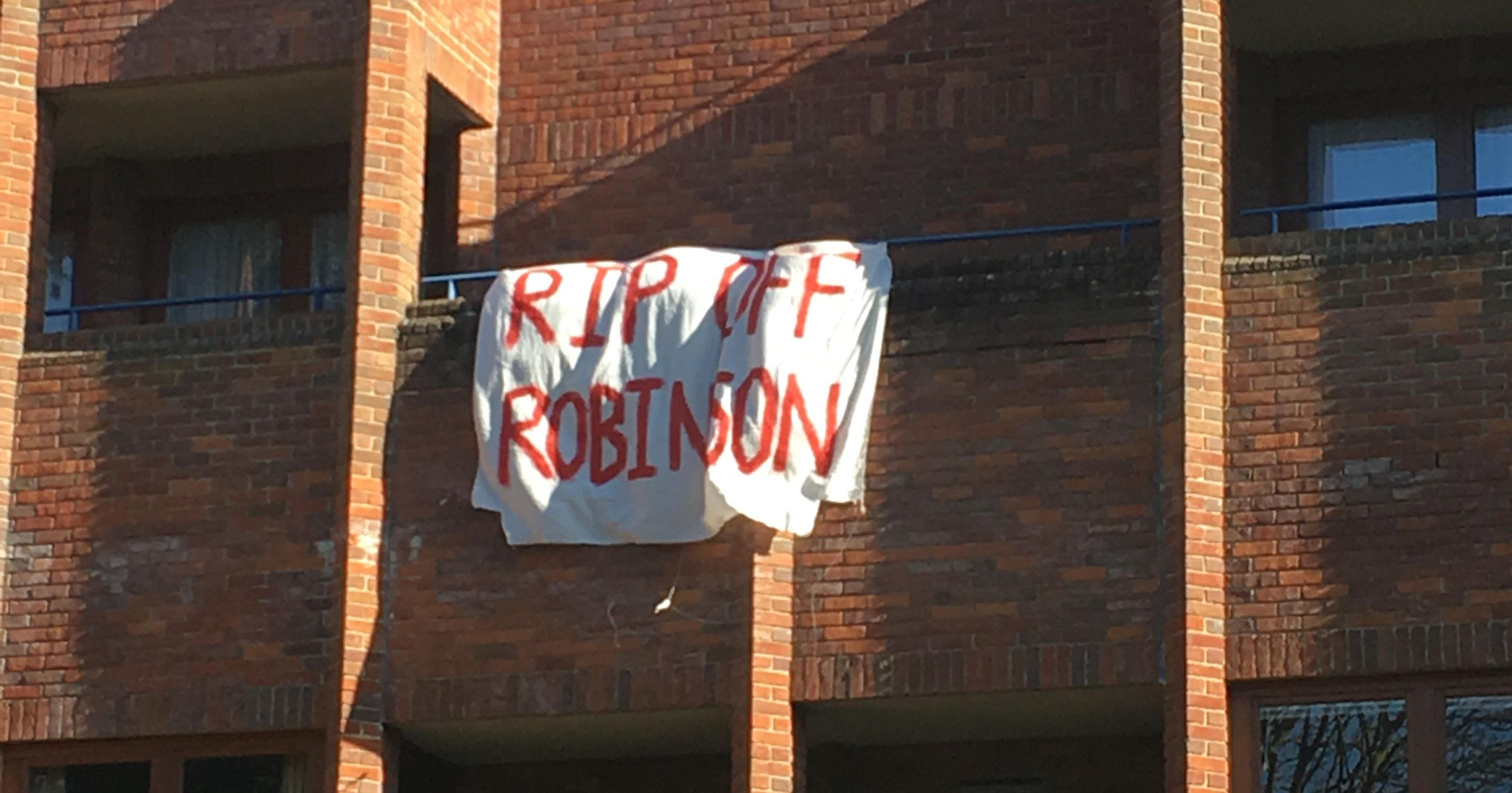 Robinson Rent Banners Broadcast Student Concerns
