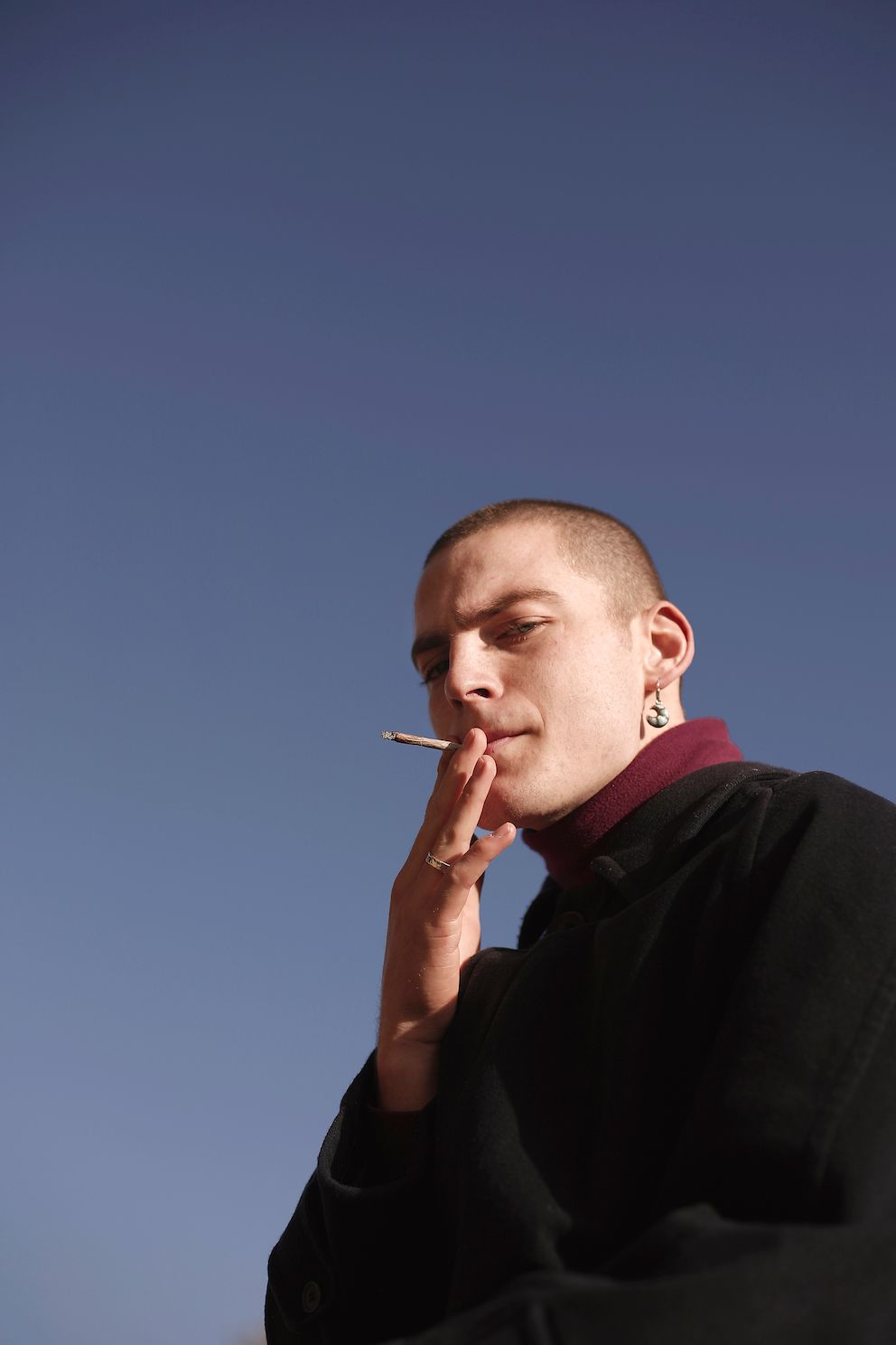 Image may contain: Smoking, Smoke, Person, Human