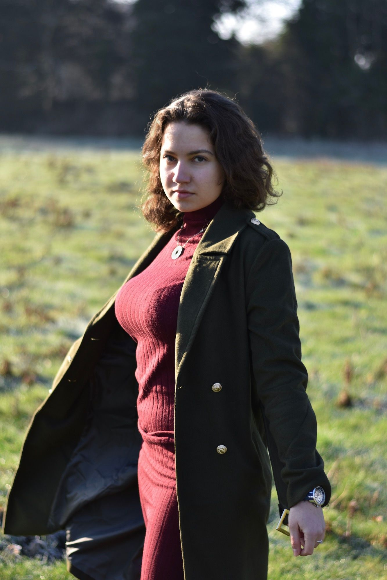 Image may contain: Sleeve, Person, Human, Overcoat, Blazer, Jacket, Coat, Apparel, Clothing
