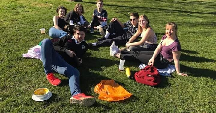 Image may contain: Jeans, Denim, Leisure Activities, People, Sitting, Yard, Nature, Park, Lawn, Outdoors, Food, Meal, Apparel, Clothing, Pants, Student, Human, Person, Grass, Plant
