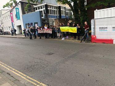 Image may contain: Protest, Tarmac, Asphalt, Parade, Neighborhood, Crowd, City, Road, Building, Town, Urban, Street, Pedestrian, Human, Person