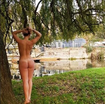 Image may contain: Grass, Nature, Land, Tree, Water, Outdoors, Vegetation, Plant, Person, Human, Back